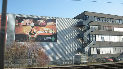 billboard on side of building-train ride from Zurich to Uster