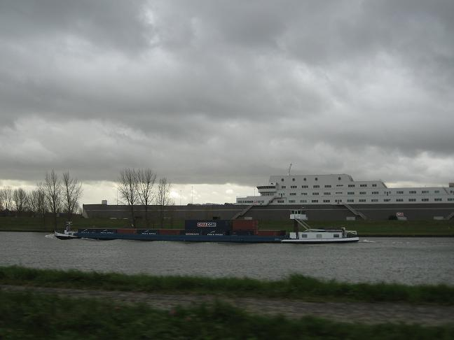 Barge and cruise ship on canal