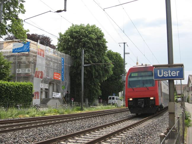 Uster sign with train