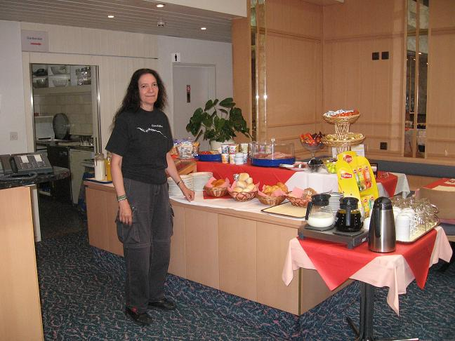 Cindy in front of breakfast spread