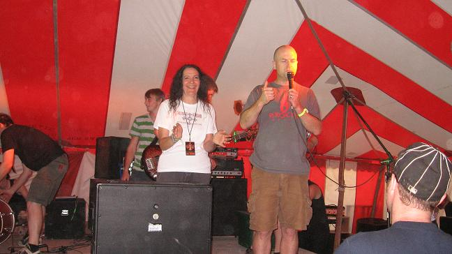Cindy on Sanctuary Stage with Matt from Bombworks Records.