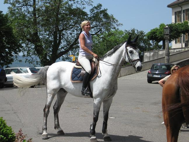 Lady mounted her horse for Sunday afternoon ride.